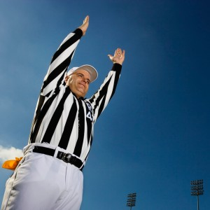 Referee Signaling Score --- Image by © Royalty-Free/Corbis